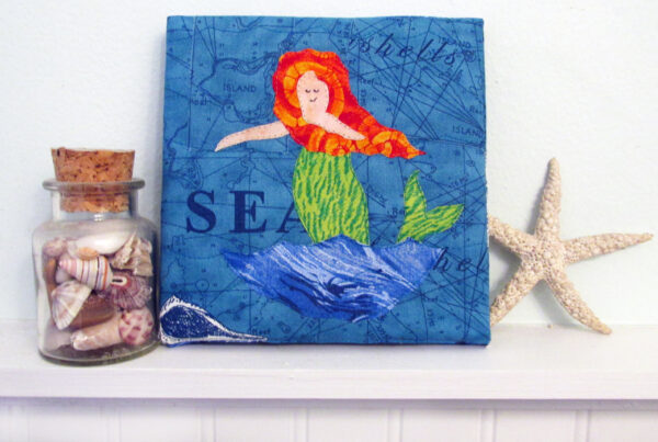 There Be Mermaids mini art quilt
